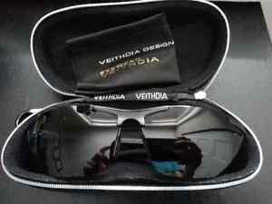 New polarized sun glasses with case