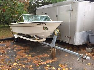 "Free 14"" fibreglass boat. trailer not included but available"