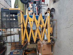 Heff-T-Herman 20' scissor lift.  In good working condition.