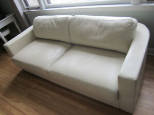 Cream colored chesterfield/sofa/coach Faux Leather.