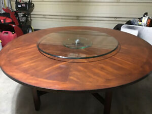 Solid 70 inch round table.