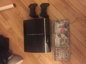 PS3 + 2 manettes + 3 jeux