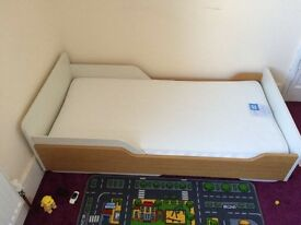 Aspace toddler bed with mattress.