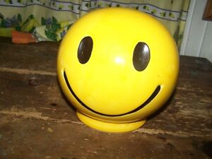 A Cheerful Bright Yellow McCoy Pottery Smiling Happy Face Bank