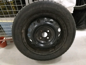 "Four 15"" continental winter tires on rims"