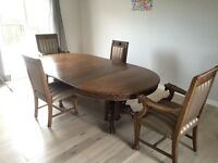 Hand carved dining room table and 4 chairs.