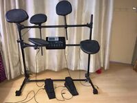 Electric drum kit + drum seat + Phillips 5m headphones + drum sticks