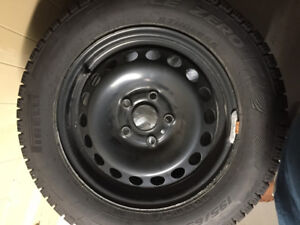 """Set of 4 practically new 15"""" inch winter tires on Steel rims"""