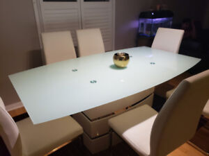 I have a dining table with 6 chairs, one year old for sale.