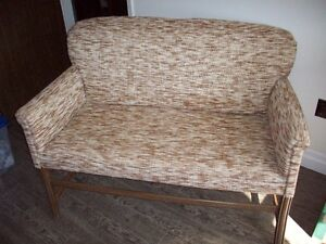 older style  Love Seat that was reupholstered