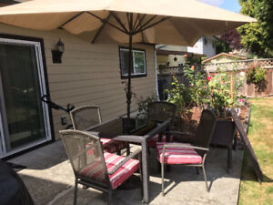 Patio set with cushions, umbrella and cast iron stand