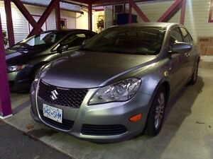 2011 Kizashi ** comes with winter tires** must sell **