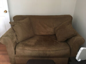 Brown Suede Chair and a half that turns into a hide abed.