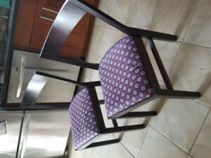 Two solid wood dining chairs with new recovered seats 20$/pair