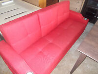 Brand New.  Red Fabric fold down couch