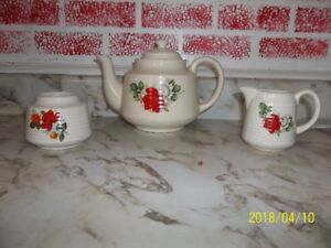 Teapot, cream and sugar bowls with rose pattern
