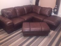 Brown, leather corner sofa and foot stool.