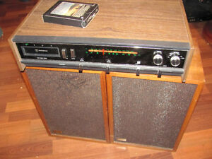 1970s wood grain 8-track stereo receiver with pair of speakers