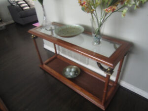 Hardwood, glass, and bronze living room table set