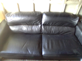 Two and three seater black leather sofa