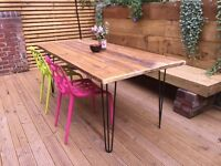 Reclaimed wooden table with metal hairpin legs.