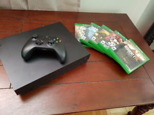 Xbox One X with games.