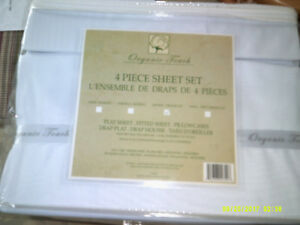 This is a Queen Size 4 Piece Sheet Set White From Organic Touch.