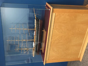 Cutty Sark ship model In Glass on oak cabinet