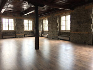 Office Space Available! Wood Floors, Brick Walls, Large Windows.