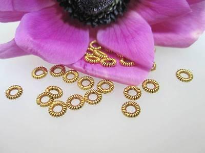 GZ03 -- Ein Echtgoldzwischenelement aus 750er Gold Flechtring