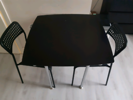 Black table with two black chairs