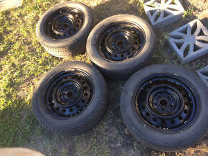 Steel Rims with M+S Tires 205/55/R16 - 5 Bolt Pattern