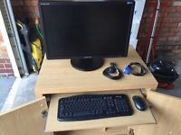 Computer cabinet, monitor, net gear router, wireless keyboard and mouse
