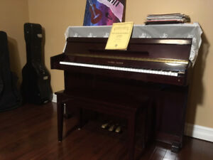 Piano with chair and lessens books
