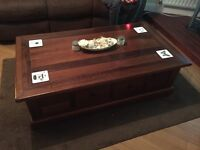 Coffee table solid dark wood, great cond. big middle draw