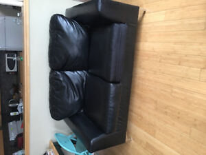 Best offer takes it!! Like New Leather love seat very comfy