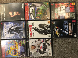 20 PlayStation 2 games and 4 remotes.