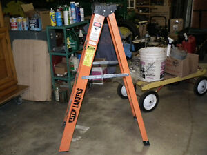 STEP LADDER  INDUSTRIAL DUTY  EXTRA STURDY BUILT .