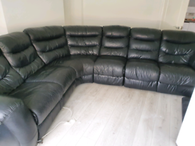 Black leather recliner corner sofa couch.