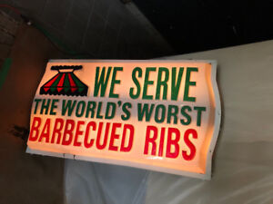 Antique mid-century outdoor vacuform BBQ restaurant sign.