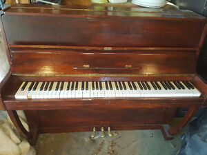 Piano for free in Raymond, AB