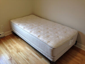 Twin sized mattress, box spring, and metal frame