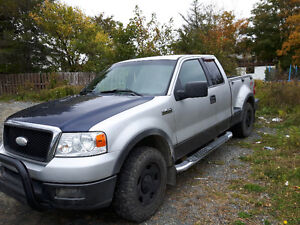 2004 Ford F-150 stepside.  Silver with black trim