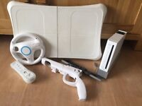 White Nintendo Wii and 15 games