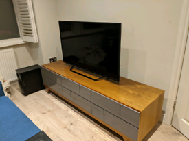 Modern, stylish TV stand with storage and cable management