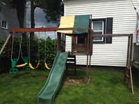 Wooden swing set with monkey bars