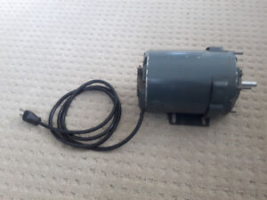 1/4 HP electric motor with arbor and bracket
