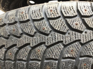 Selling 4 215/55/16 studded tires