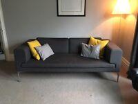 Large 2 seater/3seater sofa & footstool.