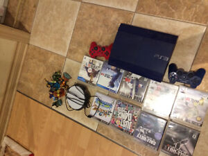 PS3 System plus 2 Controllers and Games